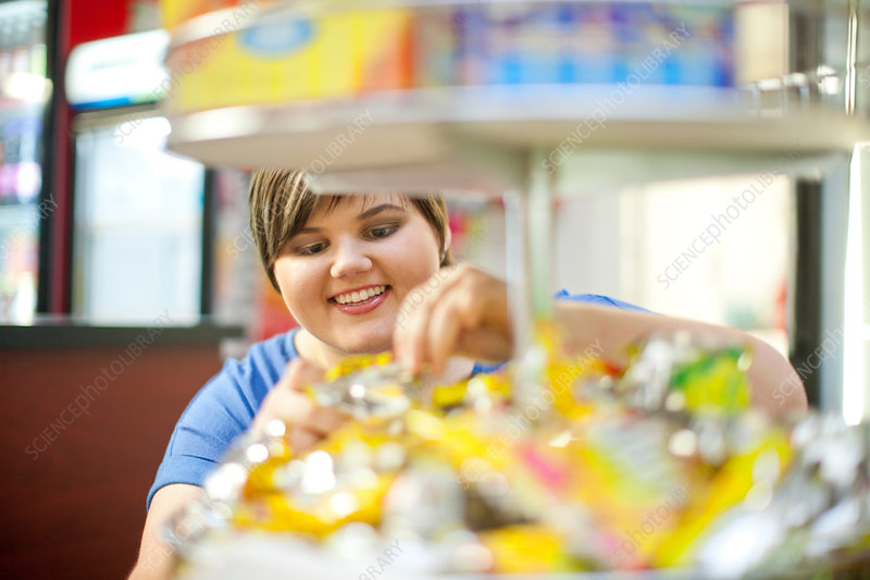 Woman selecting confectionary in cafe