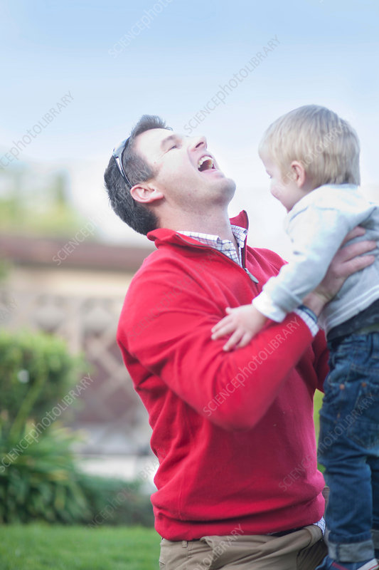 Father lifting toddler