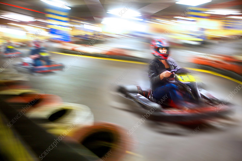 Woman driving go cart on track
