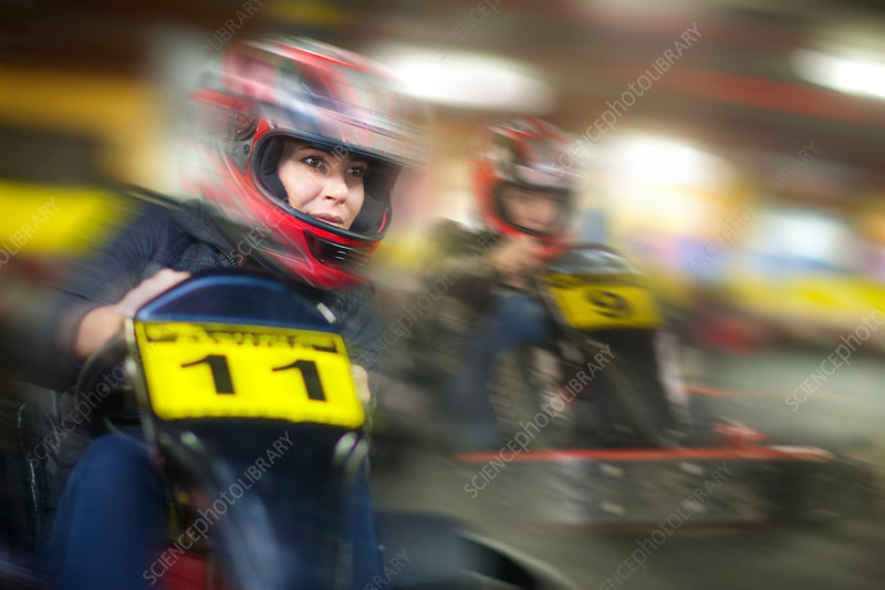 Woman racing in go cart