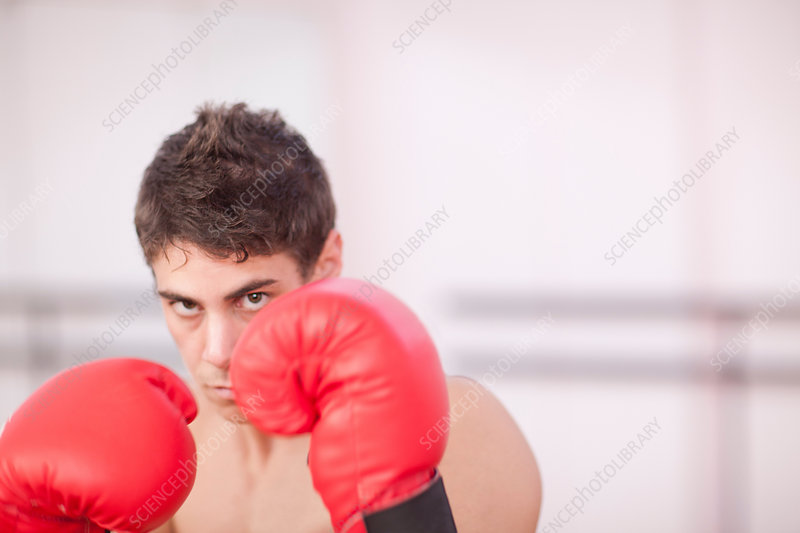 Portrait of young man in boxing gloves