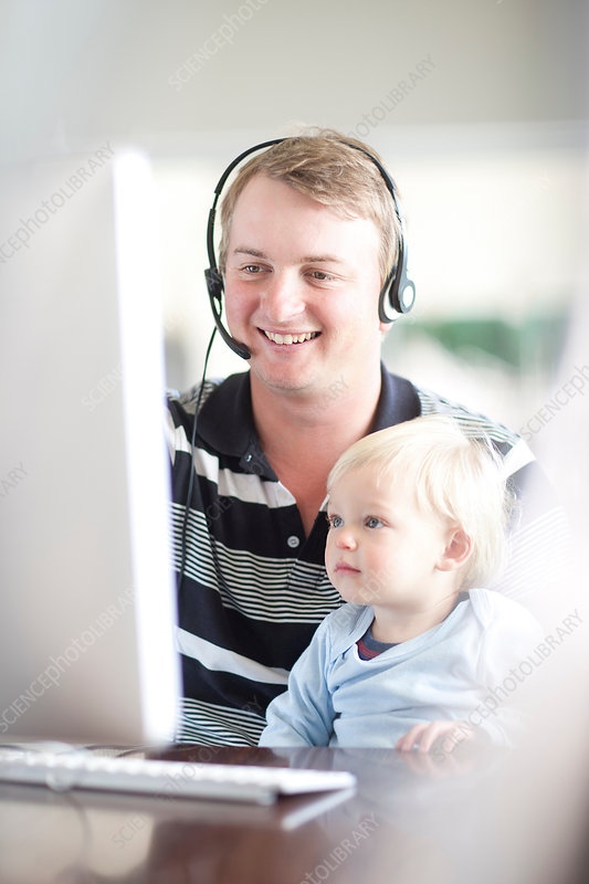 Father with baby boy using computer