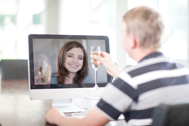 Man toasting wife using video call