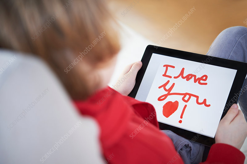 Boy holding tablet saying 'I love you'
