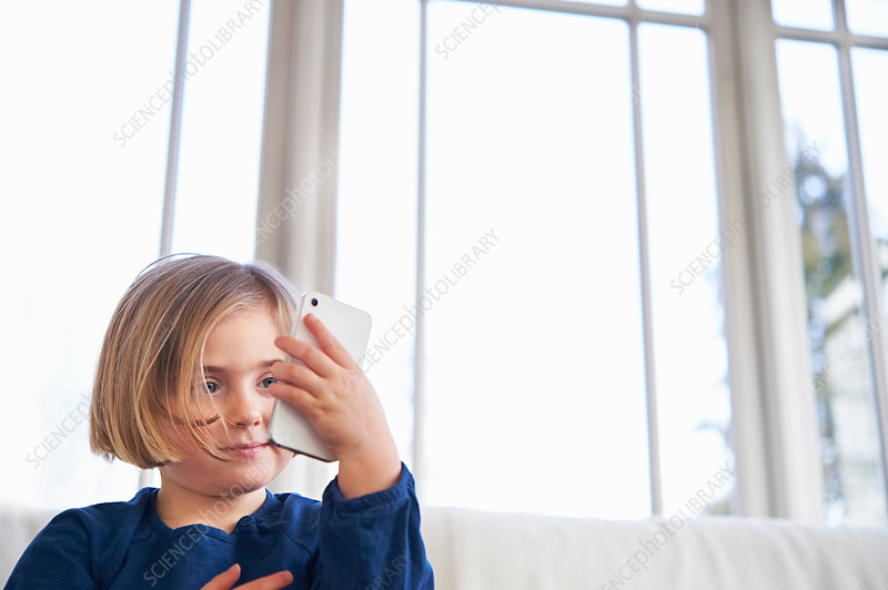 Girl on sofa using smartphone
