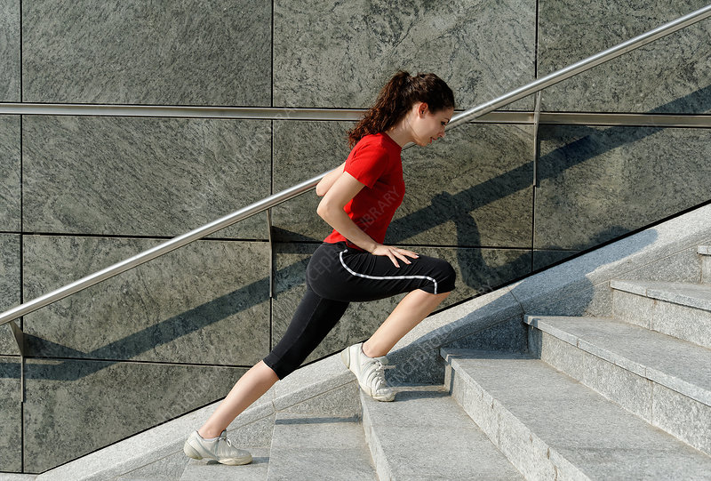 Young woman training on stairway