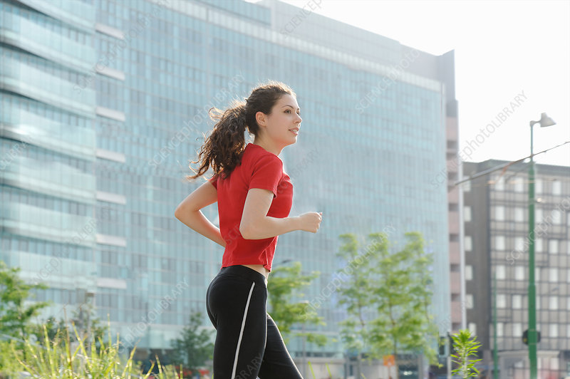 Young woman jogging in city