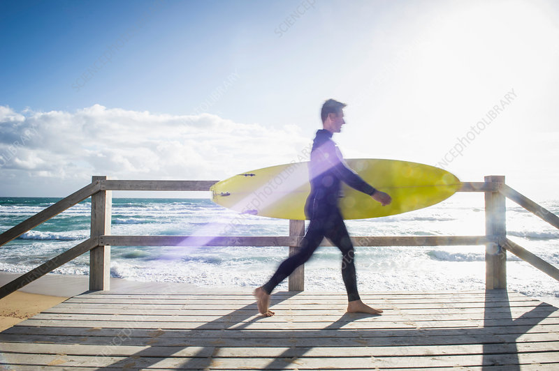Surfer walking with surfboard