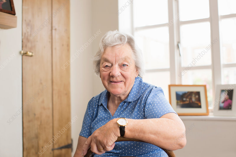 Senior adult woman sitting in room