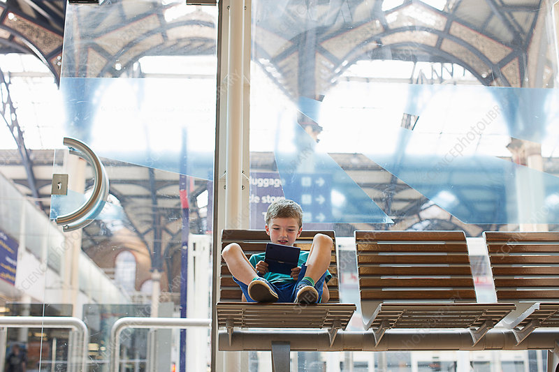 Young boy in train station waiting room