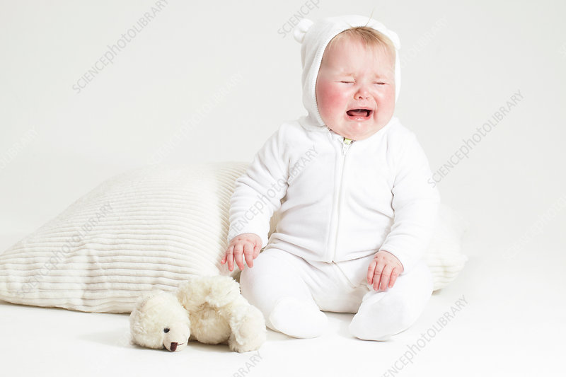 Crying baby girl and teddy bear