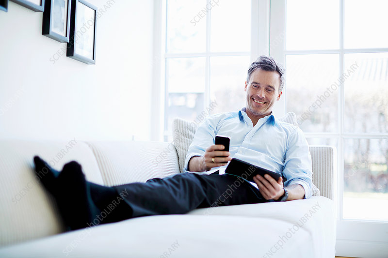 Man using digital tablet and smartphone
