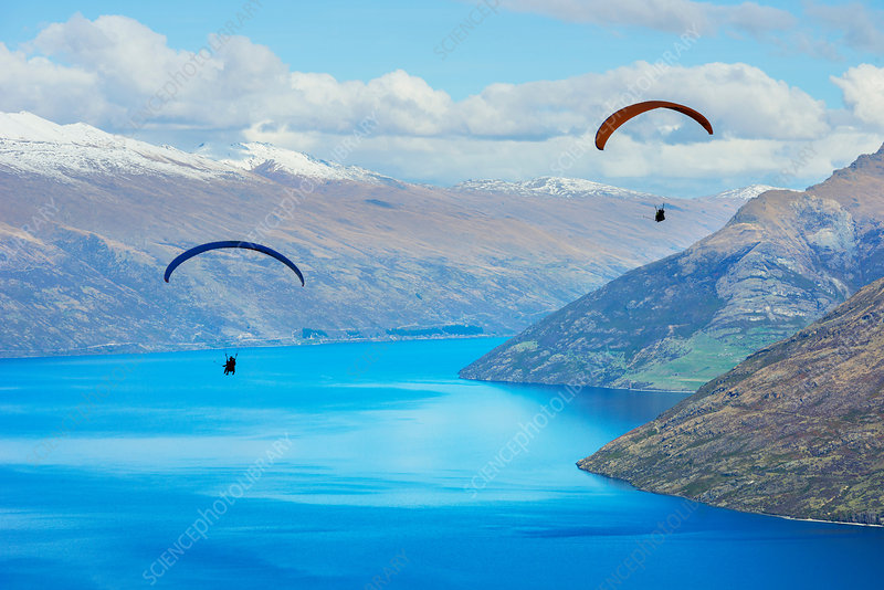 Paragliding over lake, New Zealand
