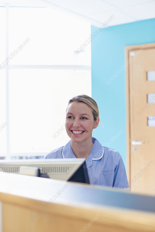 Nurse sitting at reception desk