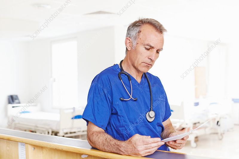 Doctor reading notes