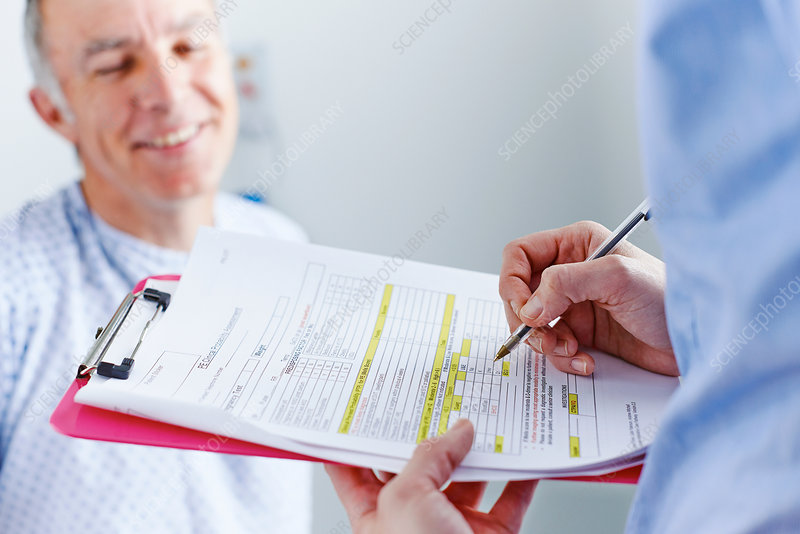 Nurse completing paperwork