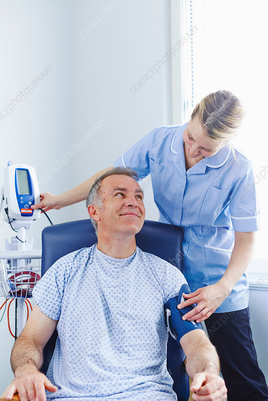 Nurse taking patient's blood pressure