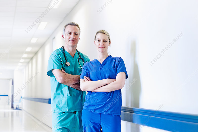 Surgeon and doctor standing in corridor