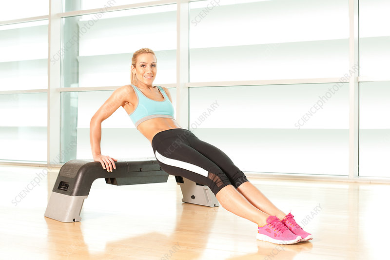 Woman exercising on step