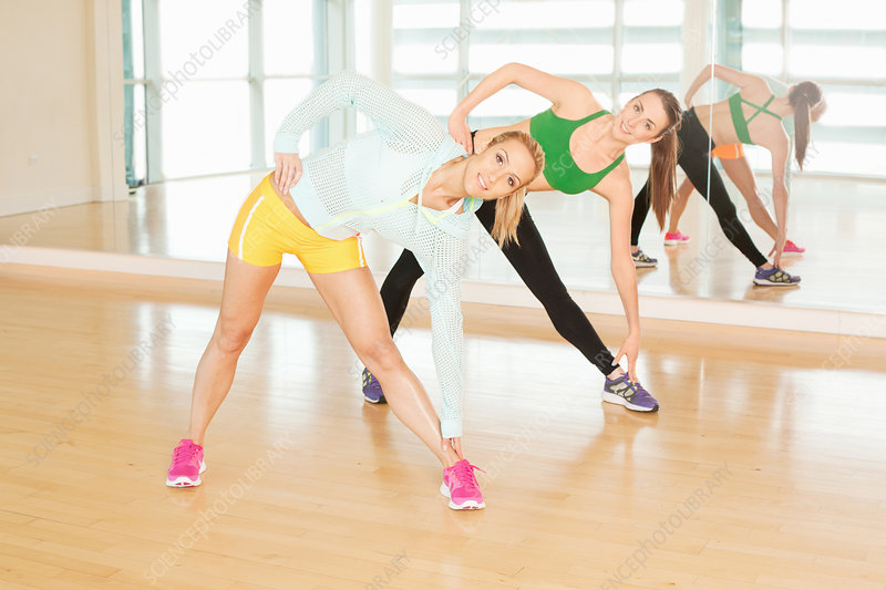 Women stretching in gymnasium