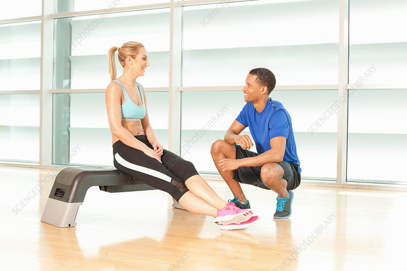 Woman talking to fitness instructor