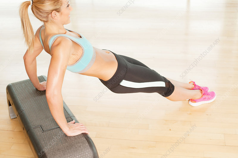 Woman stretching on step