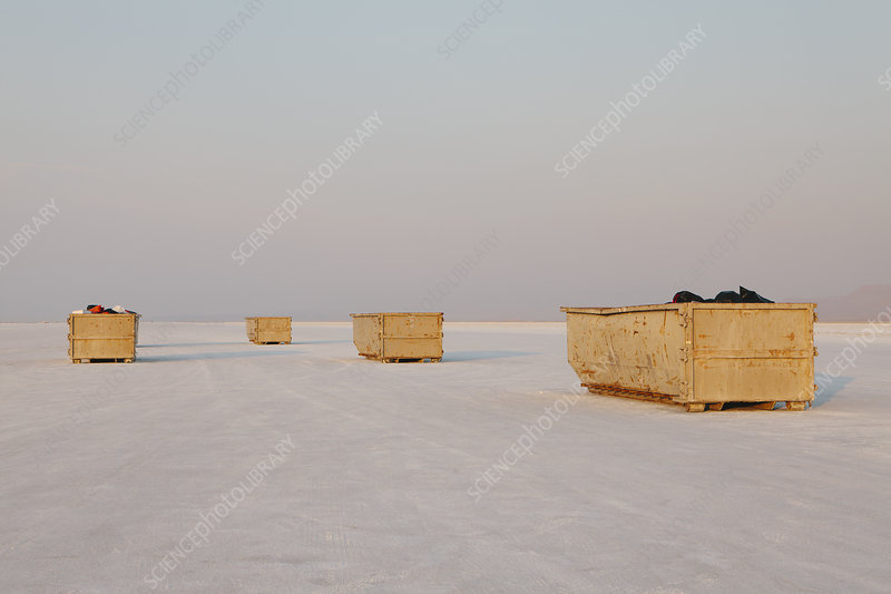 Large garbage containers on salt flats