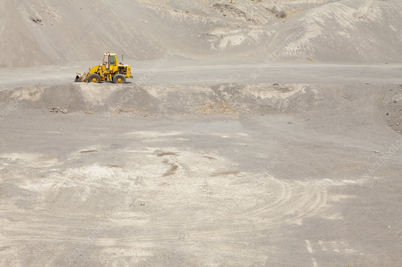 Tractor in gravel pit and mining area