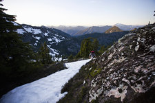 Climber on summit, Cascade Mountains