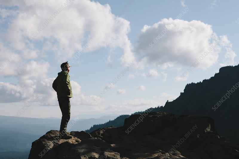 Male hiker standing on rocky cliff