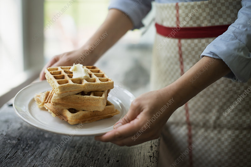 Fresh cooked waffles with cream