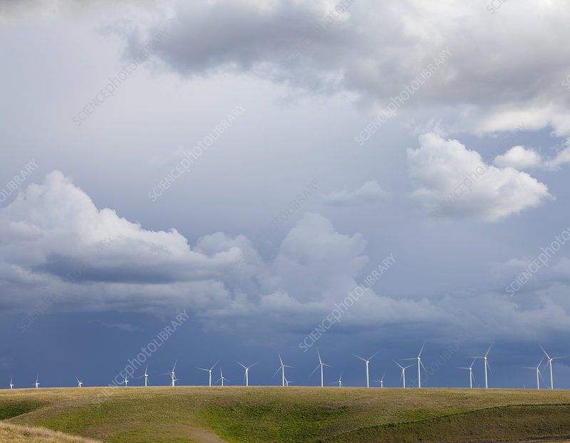 Wind turbines and storm clouds