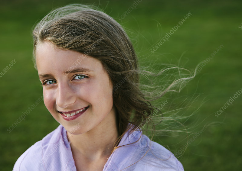Portrait of smiling nine year old girl