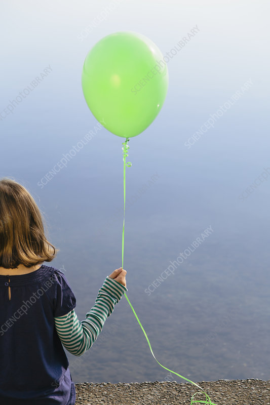 A girl holding a balloon