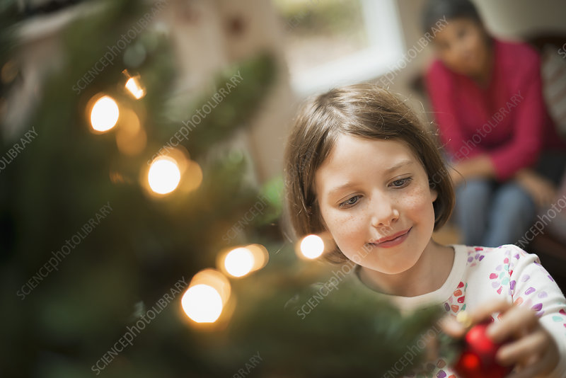 Girl with Christmas Ornament