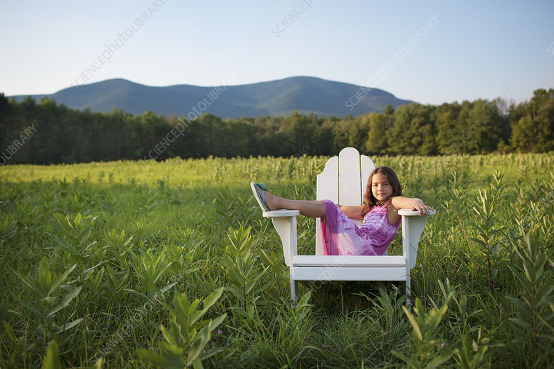 A child seated in a chair outdoors