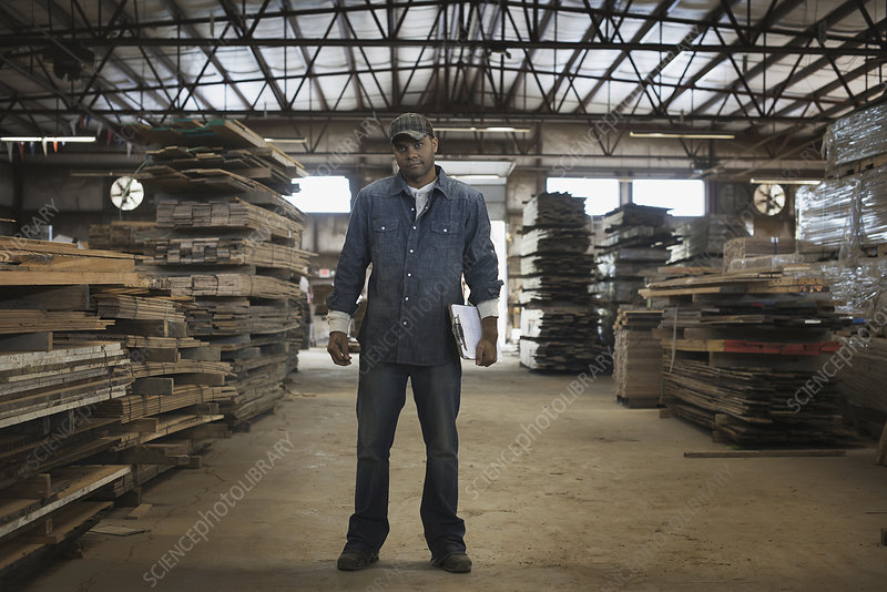 Man working on recycled reclaimed timber