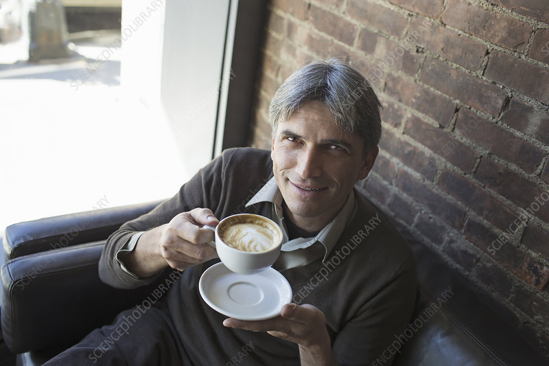 A man sitting in a coffee shop