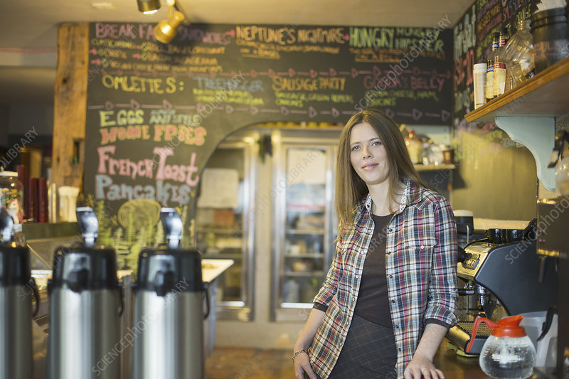 A woman at the counter in a coffee shop