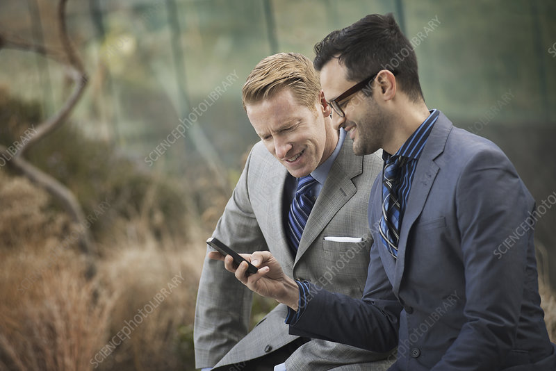 Two men looking at a cell phone screen