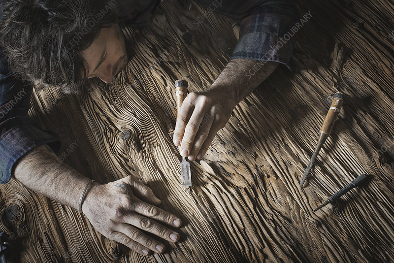 A man working in a reclaimed lumber yard