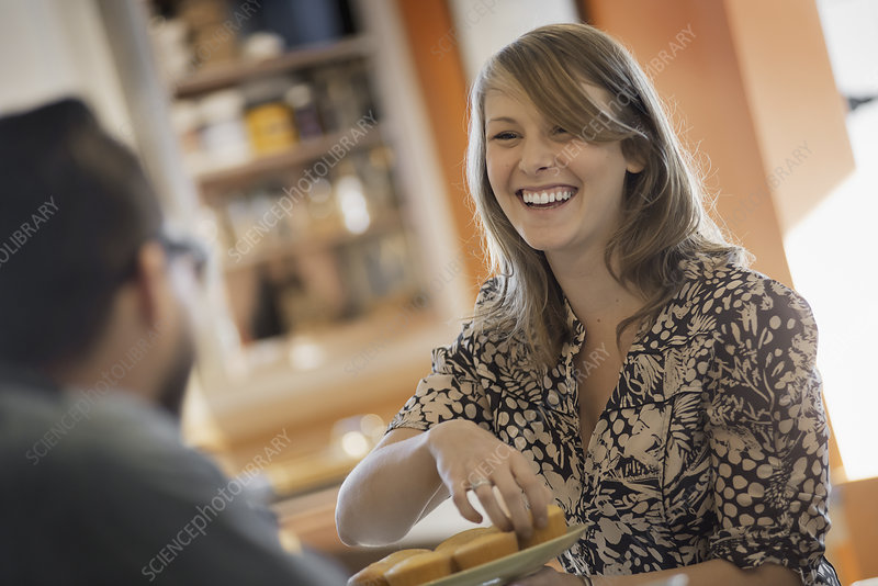 A couple sitting in a coffee shop smiling
