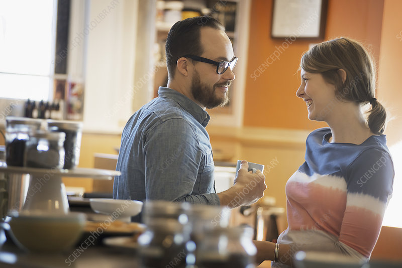 A couple talking over a cup of coffee