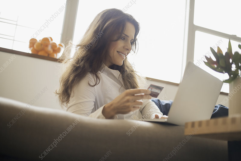 Woman on-line shopping on a laptop