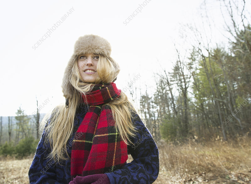 A woman in a warm furry hat