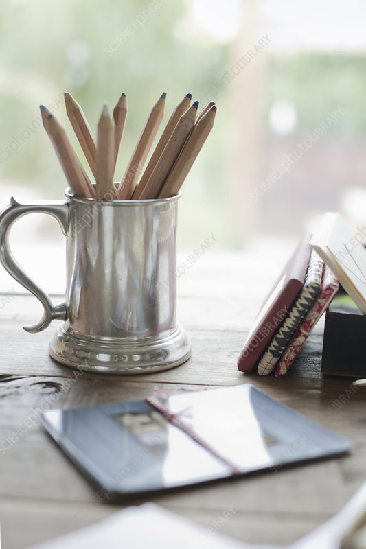 A silver tankard of colouring crayons