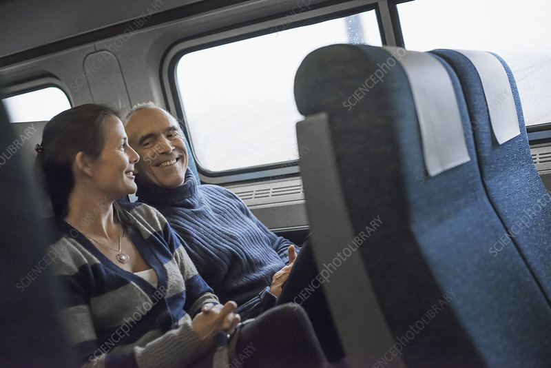 Two people sitting in a railway carriage