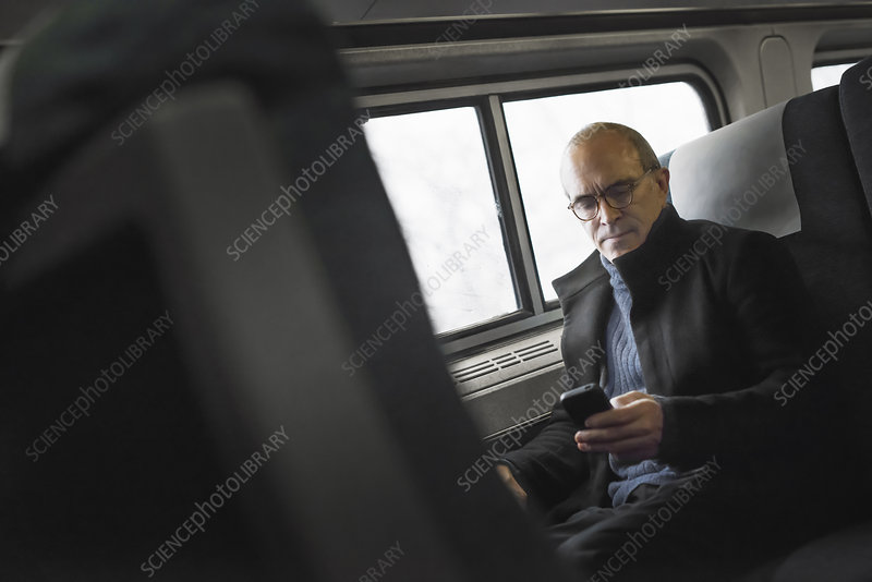 A mature man using his mobile phone