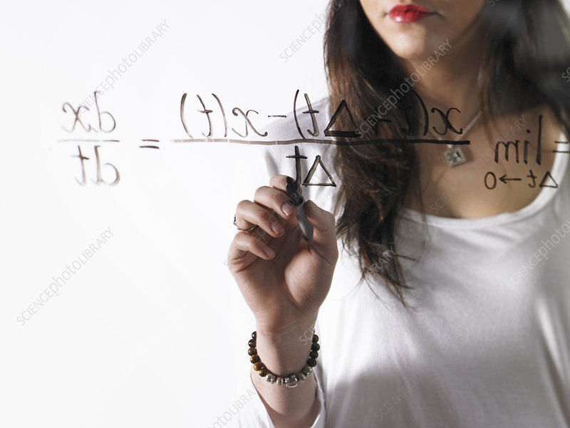 Woman writing equation with black marker