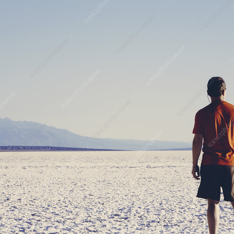 A man in a red shirt on salt flats